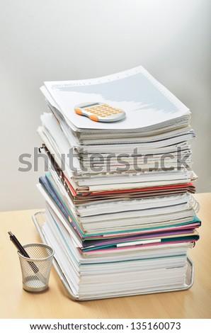 A huge pile of paperwork on a desk
