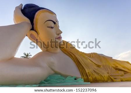 A huge reclining Buddha in Bago in Myanmar Burma