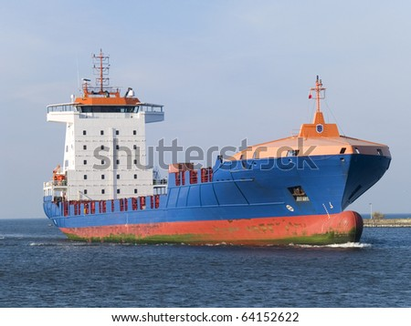 A huge ship leaving a harbour