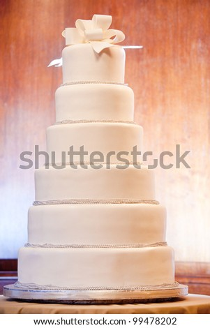 a huge six level white wedding cake on display