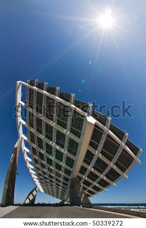 "A huge solar panel under the sun rays. It's located in the ""forum"" area of Barcelona."