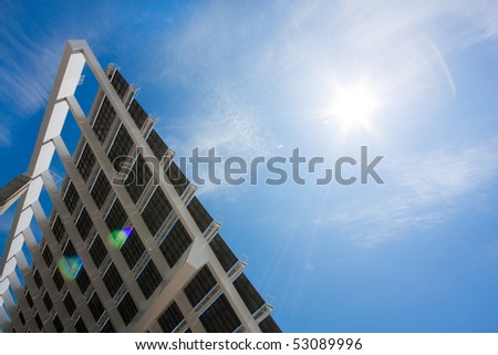 """A huge solar panel under the sun rays. It's located in the """"forum"""" area of Barcelona. Horizontal version, shot with a rectilinear wide angle lens. - stock photo"""
