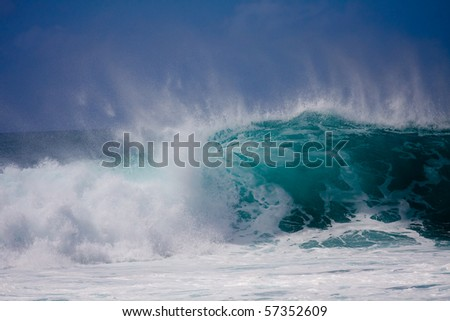 A huge wave is crashing on the beautiful Hawaii Oahu's North Shore