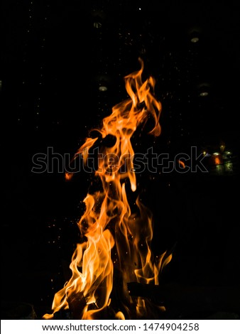 A human alike structure coming out of the blazing fire #1474904258