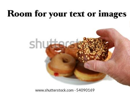 a human hand grabs a donut