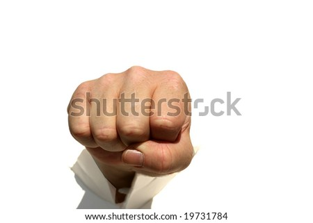 a human hand punches though a hole in a wall isolated on white
