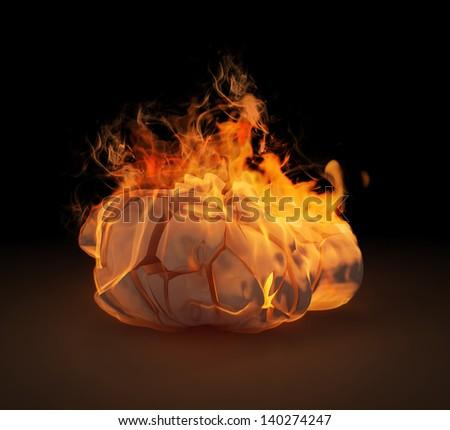 A human head sculpture in flames