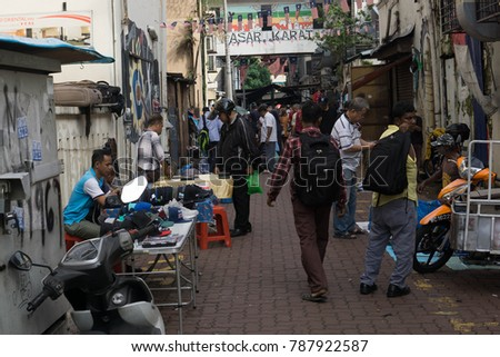 A human interest street view of a people trading old secondhand  goods at a junk yard lane at China Town, Kuala Lumpur Malaysia on 26/12/17 #787922587