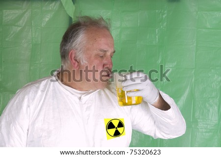 a humorus take on a man breathing hazardous chemical in a flask in a radioactive clean room