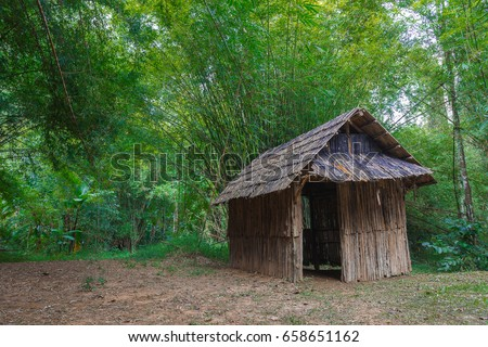 A hut in forest, old hut and vintage hut. - Shutterstock ID 658651162