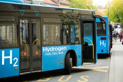 A hydrogen fuel cell buses stands at the bus station