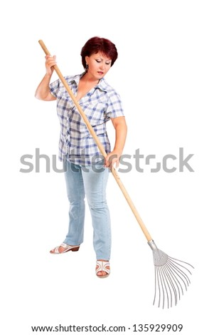 a image of woman farmer with rakes in hands