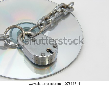 A image showing Chain,lock and CD. This can be conceptual image for software piracy & copyright.