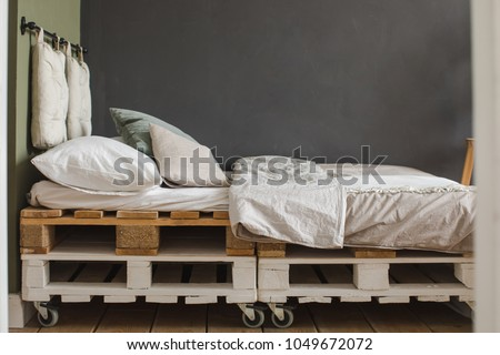 A industrial style bedroom with recycled pallet bed frame designs