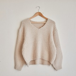 A ivory sweater isolated on a white background
