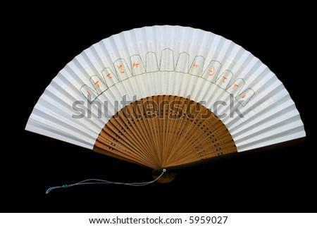 A Japanese fan on black background.