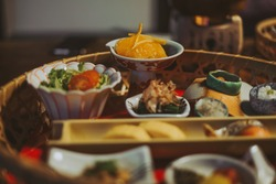 A Japanese gourmet kaiseki dinner made of many small dishes, served in a traditional hotel ryokan. Location: Kumamoto, Kyushu