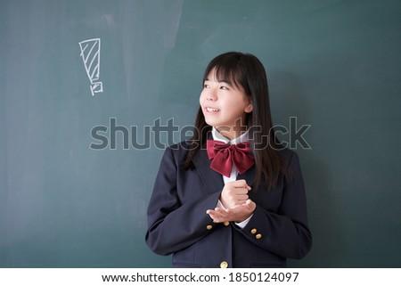 A Japanese junior high school girl in a classroom ストックフォト ©