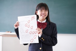 A Japanese junior high school girl who scored 100 on a test