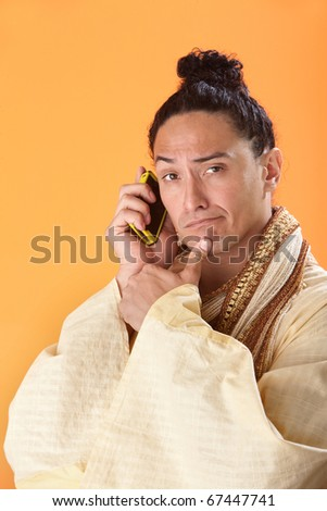 A Japanese Samurai thinking while talking on a mobile phone