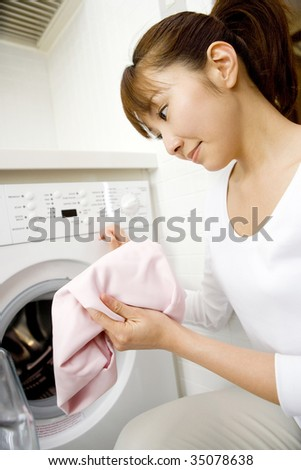 A Japanese woman  washing clothes