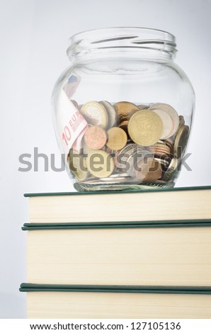 A jar of coins with savings for education