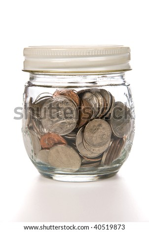 A jar of pock changes coins being saved for a rainy day.
