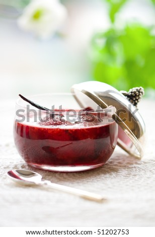 A jar of strawberry jam with vanilla