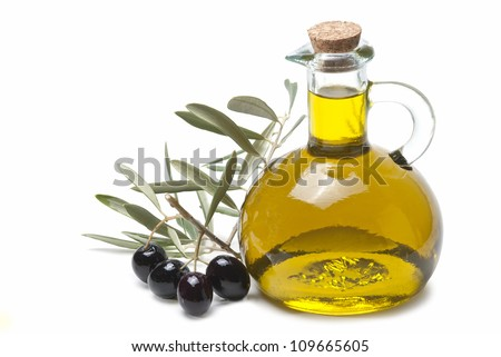 A jar with olive oil and some black olives isolated over a white background. - stock photo