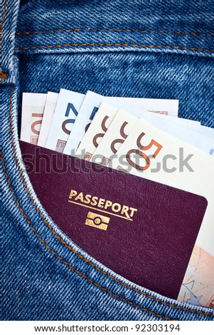 A jeans pocket with a passport and Euros bank notes.