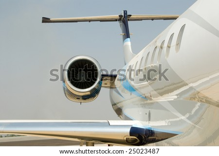 A jet engine and tail wing - stock photo