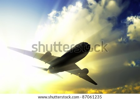 A jet flies away in the rays of sun.