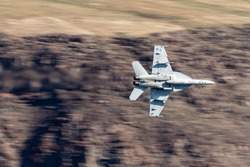 A jet flies through star wars canyon