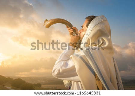 A Jewish man blowing the Shofar (ram's horn), which is used to blow sounds on Rosh HaShana (the Jewish New Year) and Yom Kippurim (day of Atonement)