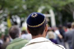 A Jewish man wears a blue Kippah with a Star of David on it in Sao Paulo, Brazil.