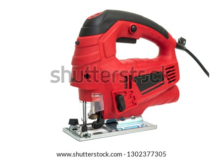 A jigsaw power tool isolated on white background. Electric jig saw. Professional electric jig saw isolated on white background. Electric fretsaw on a white background