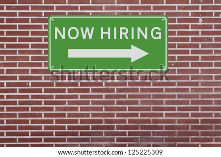 A job opportunity sign on a red brick wall