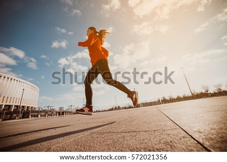 a jogging woman runs on the...