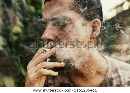 A Joint In Hand A Man Smokes Cannabis Weed. Concepts Of Medical Marijuana Use And Legalization Of The Cannabis.