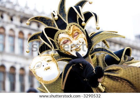 A joker with his mask at the Venice carnival