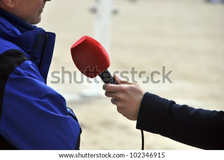 A journalist is making an interview to somebody - stock photo