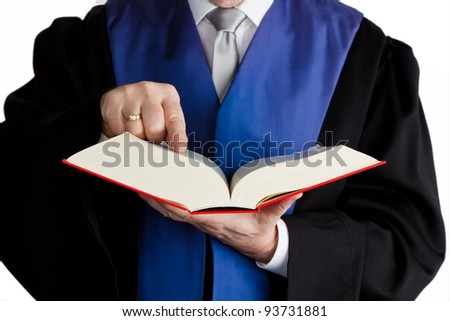 a judge holds a law book in his hand. verdict at trial
