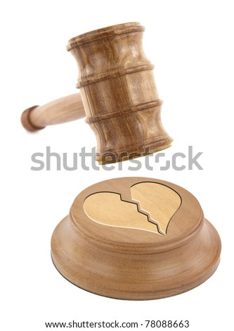 A judge?s gavel coming down on a broken heart design