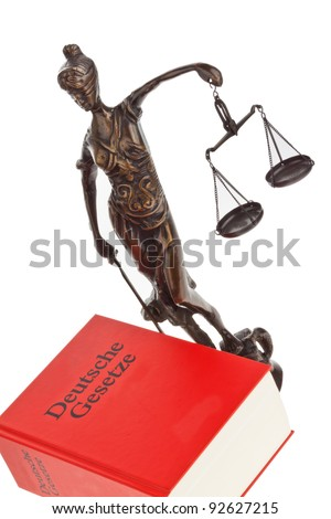 a judge with a german law book in court
