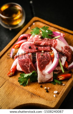 a juicy and juicy meat and spices on a wooden board #1508240087