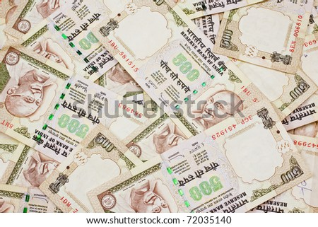 A jumbled pile of Indian five hundred rupee notes.