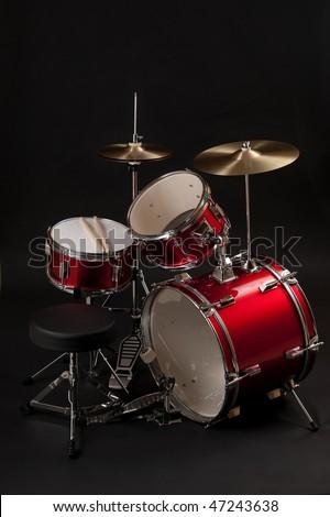 A junior drum kit isolated in dark background