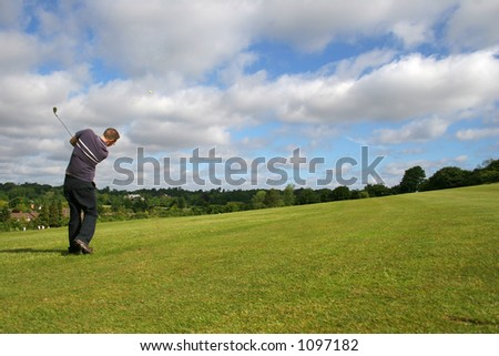 A junior golf champion lofts the ball