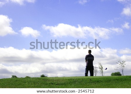 A junior golf champion looks for the green
