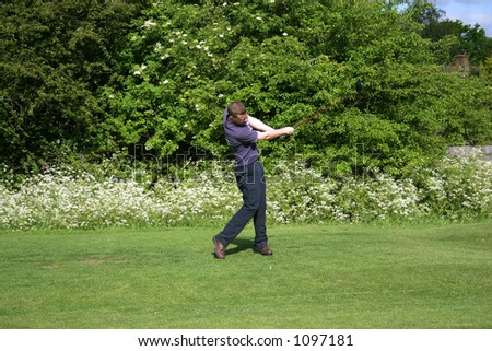 A junior golf champion practices